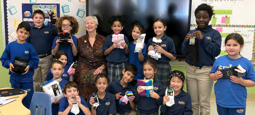 Children collected socks for Sr. Peggy McEntee to deliver to LEFSA.